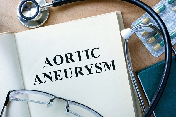 Aortic Aneurysm Concept. Book With Stethoscope And Pills.