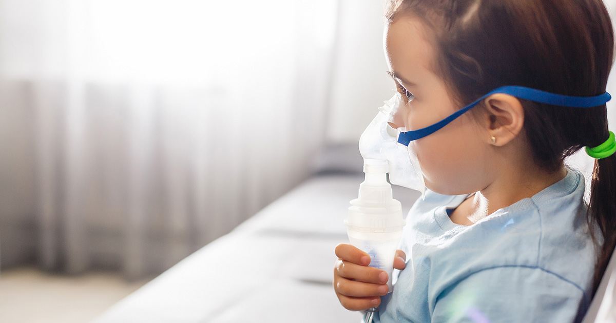 Little Girl In A Mask, Treatments Respiratory Tract With A Nebulizer At Home